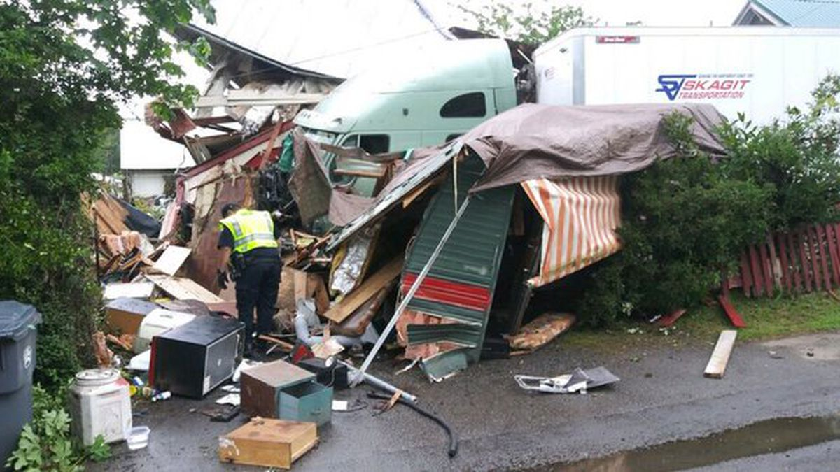 Family displaced from home after crash involving 2 semitrucks