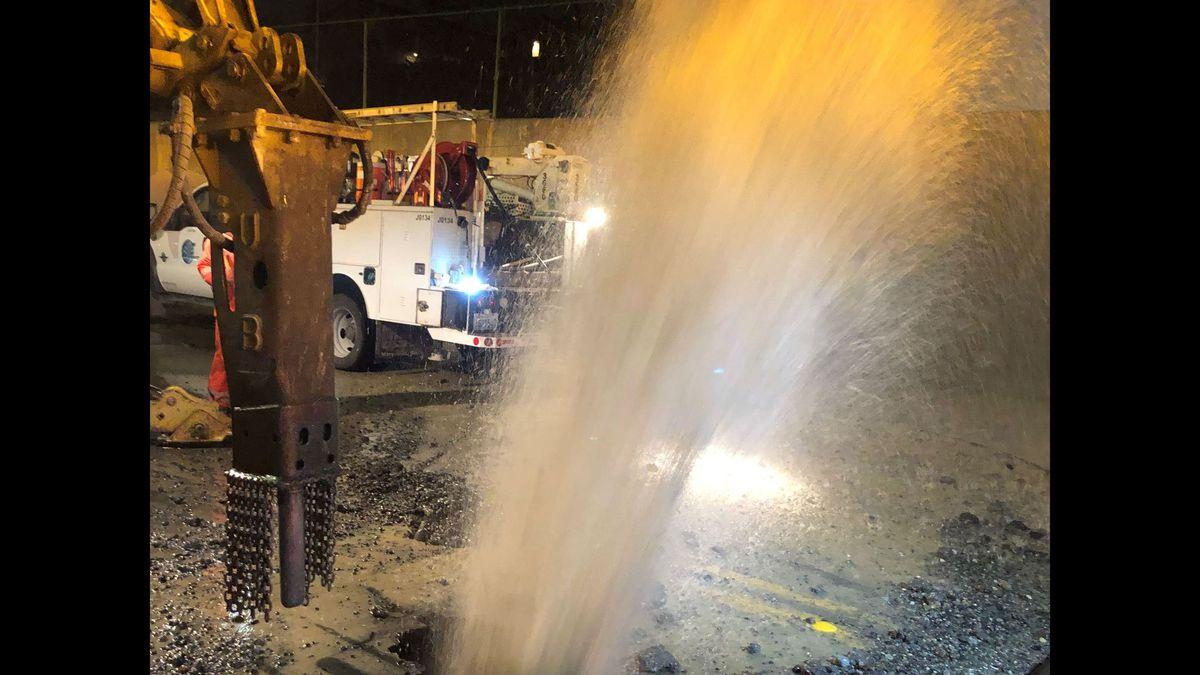 Everett water main break damages road