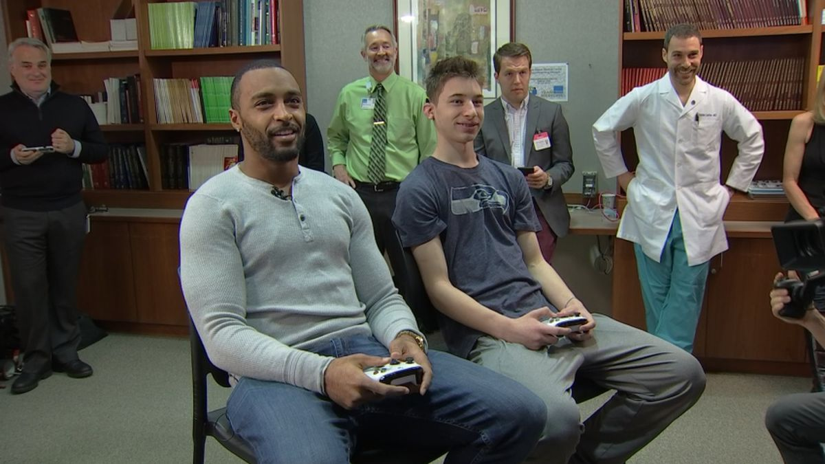 Seahawks' Doug Baldwin visits with Virginia Mason Medical Center patient