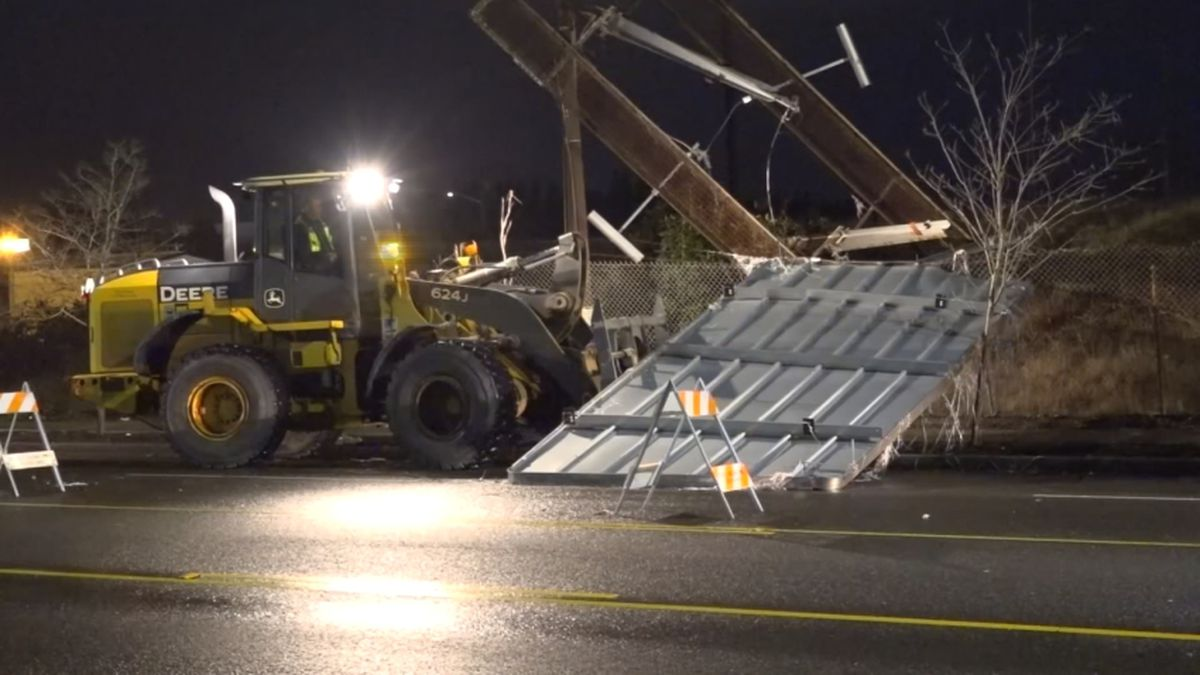 Billboard collapses, takes out power lines