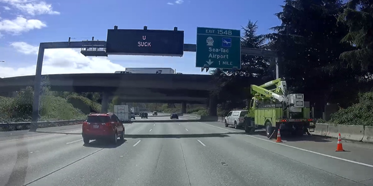 'U SUCK' appears on I-5 traffic sign