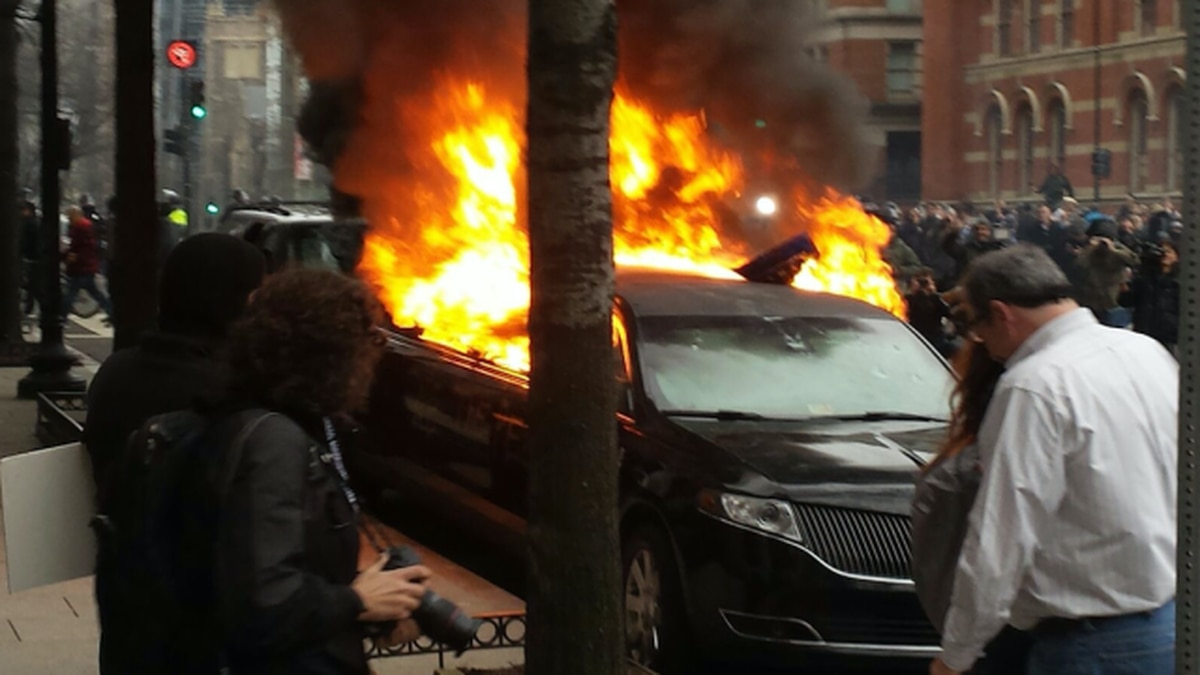 At the DC protests, a naked guy and a raging car fire