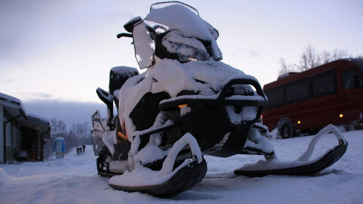 New Hampshire man dies after snowmobile falls through ice on Maine's largest lake