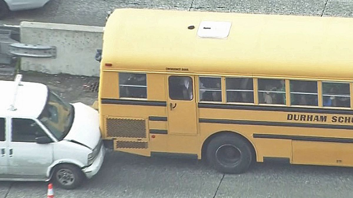 Van repeatedly runs into school bus on I-5 in downtown Seattle