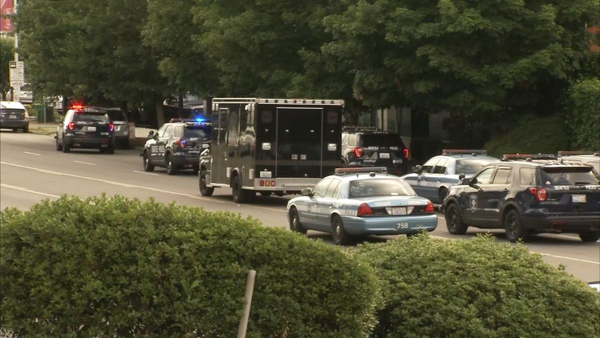 Part of Lake City Way closed for standoff with man who fired shots from patio