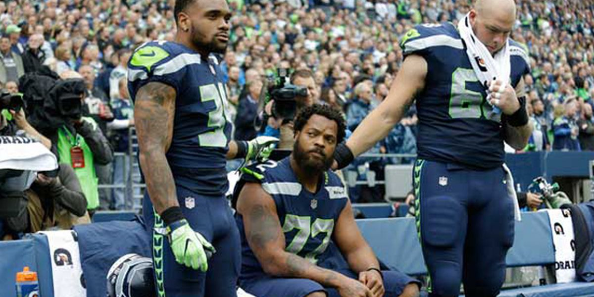 Are NFL players required to stand for the national anthem?