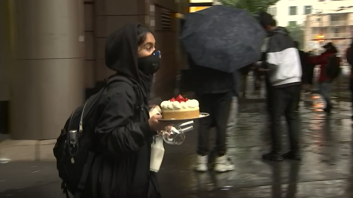 Video shows woman carrying cheesecake in midst of violent downtown riots