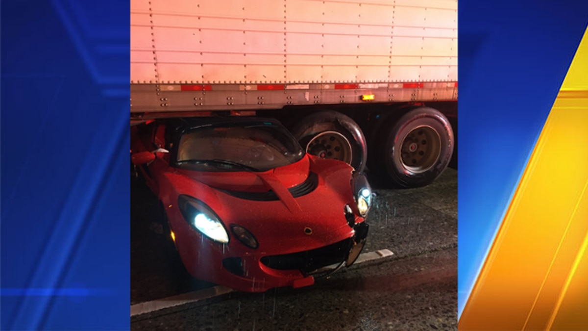 Pricey car hydroplanes, spins under semitruck carrying load of fish