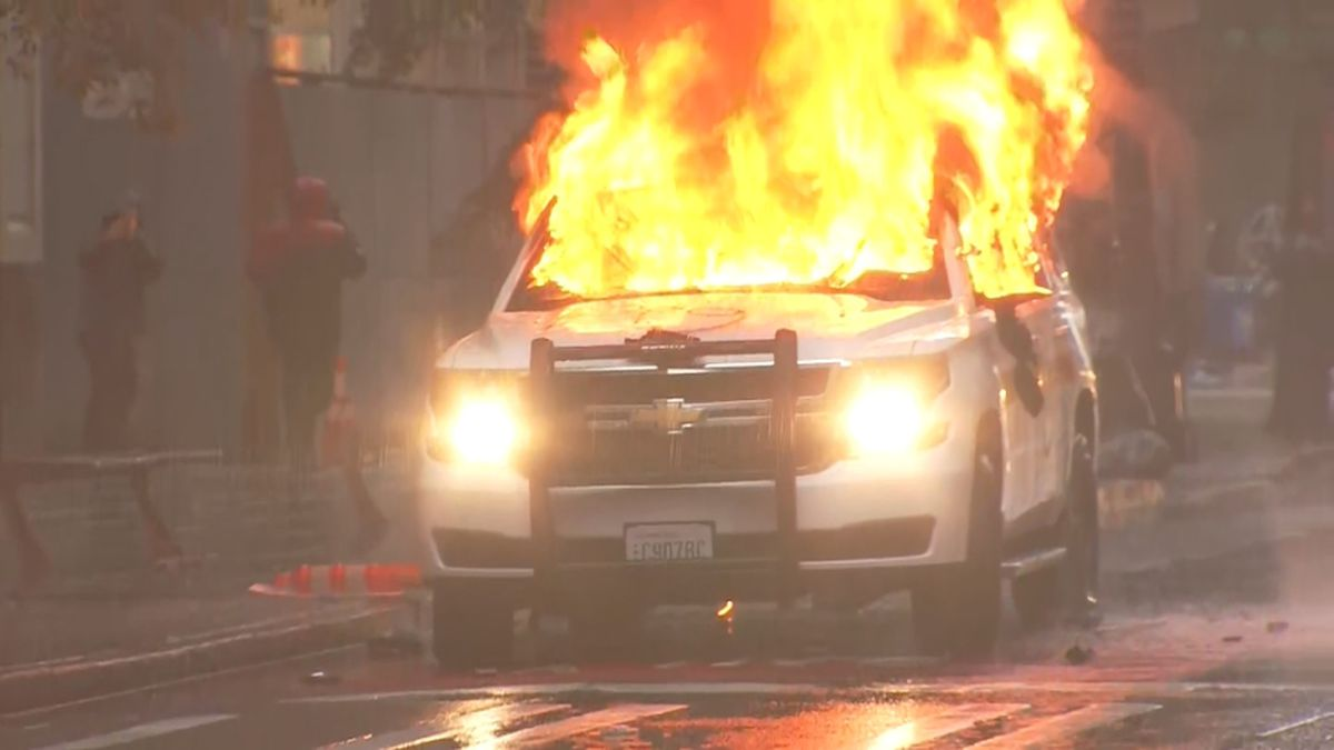 Police identify, arrest woman for hitting patrol car with baseball bat during riot in Seattle