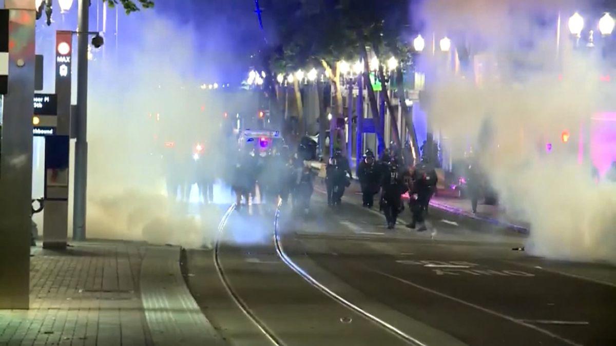 Portland police arrest 8, fire crowd-control munitions
