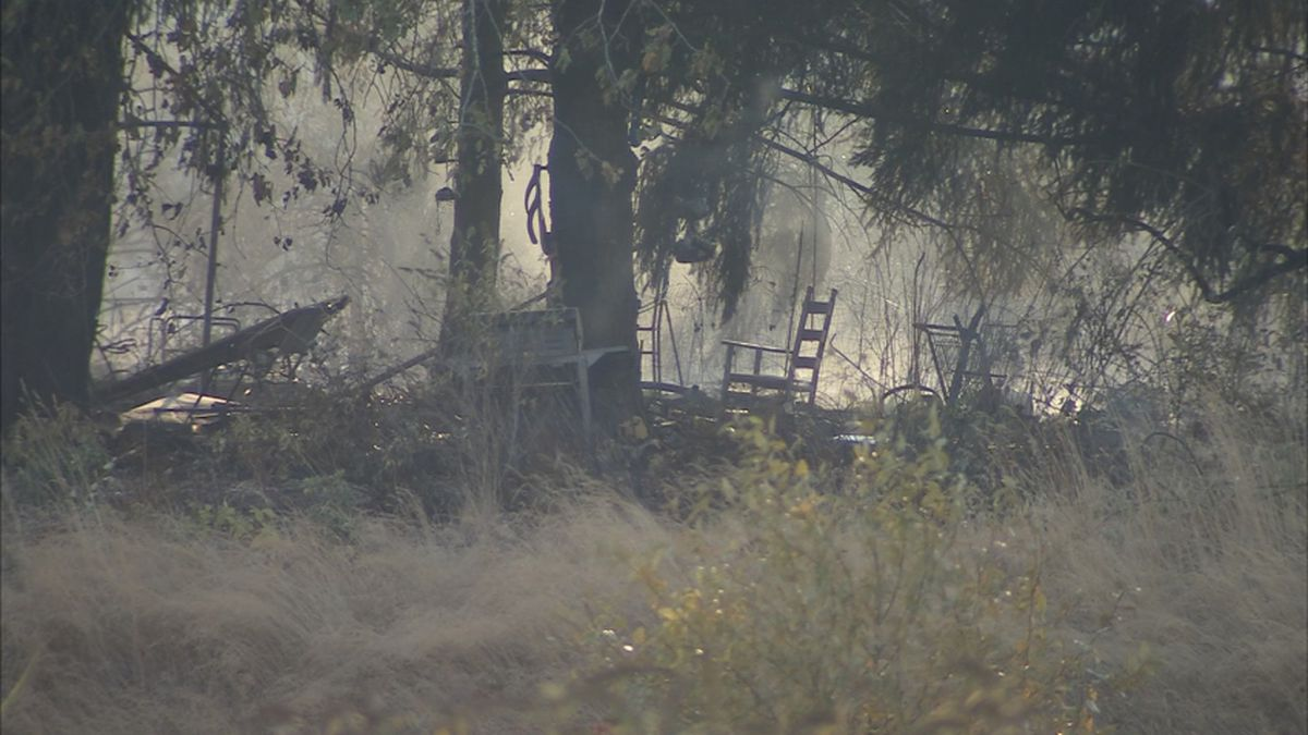 Fire started at large encampment burns 24 acres, officials say