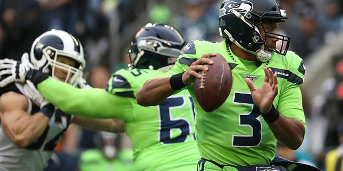 Wilson throws 4 TD passes, Seahawks hold off Rams 30-29