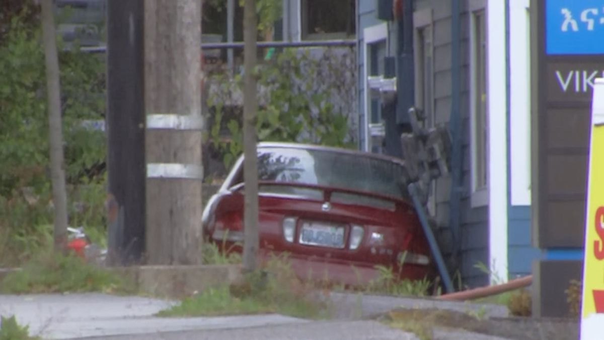 Collision results in car crashing into building, breaking gas line