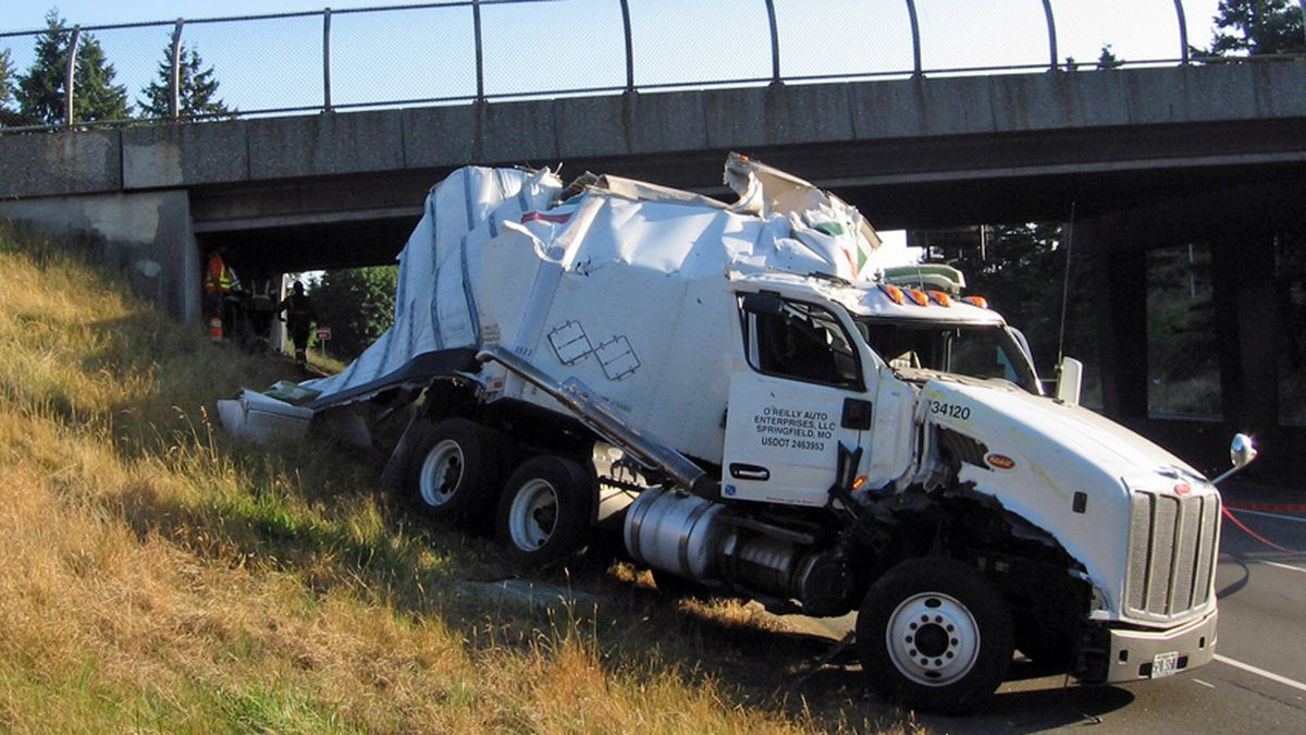 Part of semi-trailer sheered off in I-405 crash