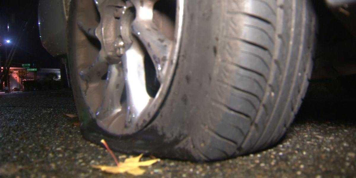 Ballard man stabbed after he confronts man slashing tires