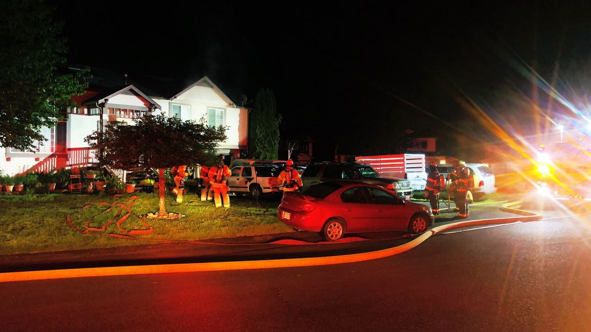 Two people burned in Lacey garage fire